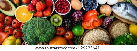 Background healthy food. Fresh fruits, vegetables, fish, berries and cereals. Healthy food, diet and healthy life concept. Top view. Long web format #1262236411