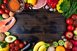 Background healthy food. Fresh vegetables, fruits, meat and fish on wooden table. Healthy food, diet and healthy life concept. Top view, copy space
