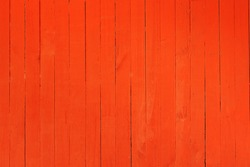 Background image of a wooden wall painted in bright orange color