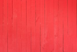 Background image of a wooden wall painted in bright red color