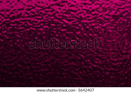 Background image of bumpy dark pink metallic texture