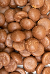 background image of chocolate 'Pepernoten' which is a traditional Dutch candy, concept for children party in Saint Nicolas day five december.