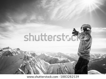 Background image of male person in ski suit with hands wide open enjoying panorama of snowy mountains Zdjęcia stock ©