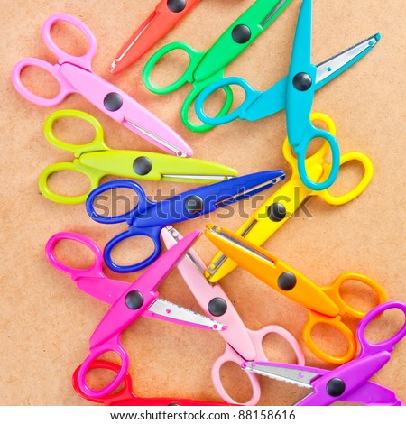 background image of many colorful plastic scissors