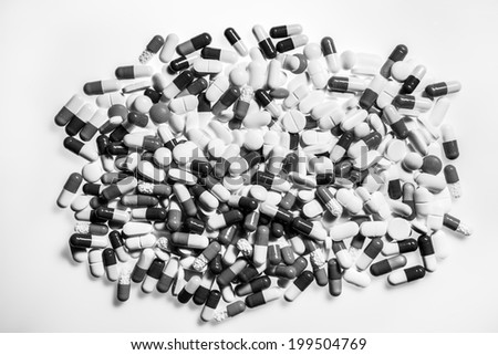 background image of many different pills shot on white #199504769