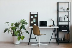 Background image of minimal home office workplace with laptop and accessories in black and white, copy space