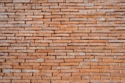 Background image random pattern. Old vintage interior texture, red old brick, and Wall brick masonry,  High-resolution image of a rustic wall.