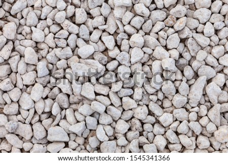 Background image - surface area covered with small white crushed stone