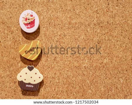 Background is Medium Density Fiberboard is engineered wood wallboard made of wood chips and other recycled materials and copy space right side to put text and pictures on demand and has Cupcake Style.