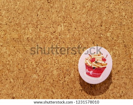 Background is Medium Density Fiberboard is engineered wood wallboard made of wood chips and other recycled materials and copy space to put text and pictures on demand and has Cupcake Style.