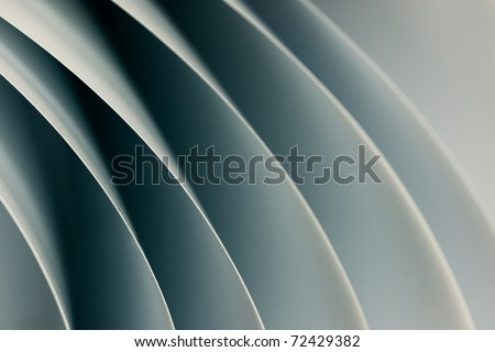 background macro image of black and white origami pattern made of curved sheets of paper.