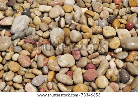 background made of a closeup of a pile of pebbles