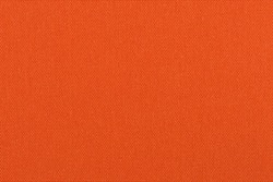 Background made of a closeup of an orange fabric texture