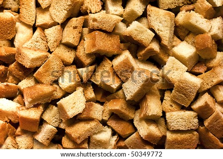 Background made of dice roasted bread (crispy croutons) - stock photo