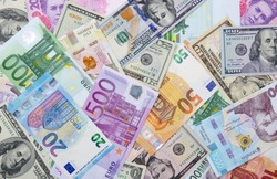 Background made of dollar, euro and hryvnia banknotes