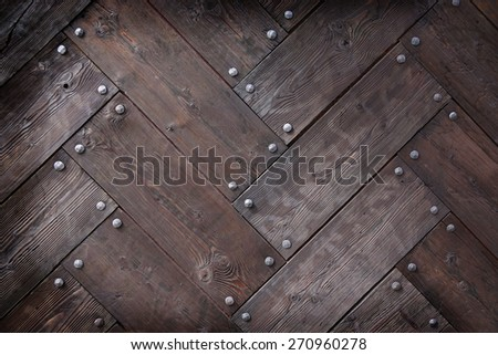 background made of weathered old wood timber planks with rivets
