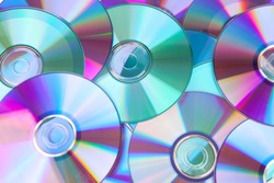 background made out of compact discs CDs in closeup