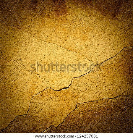 Background made with a texture of a yellow wall - stock photo