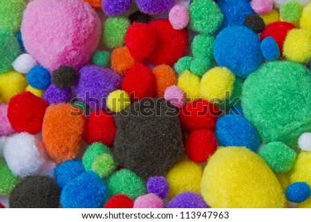 Background - many colorful different sized colorful cotton balls