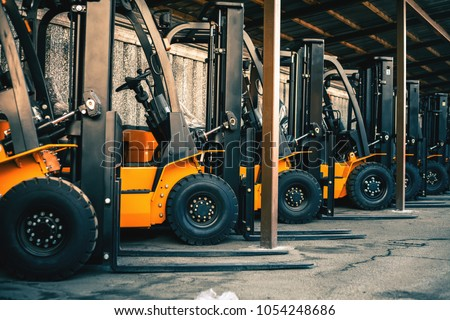 Background of a lot of forklifts, reliable heavy loader, truck. Heavy duty equipment, forklift
