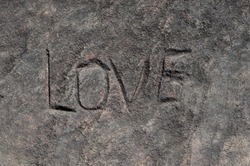 Background of a rock with the word love engraved in it