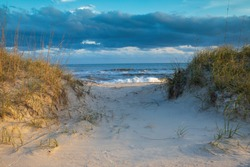 Background of a sandy beach path through the dunes to the beach in Hatteras, North Carolina on the outer banks.