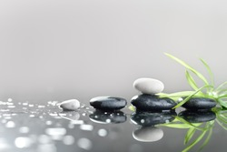 background of a spa with stones, and green leaves