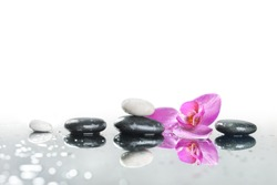 background of a spa with stones, and orchid flower