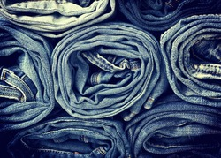 background of a stack rolled jeans (vintage)