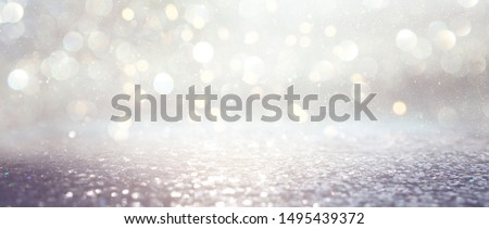 Photo of  background of abstract glitter lights. silver and gold. de-focused. banner
