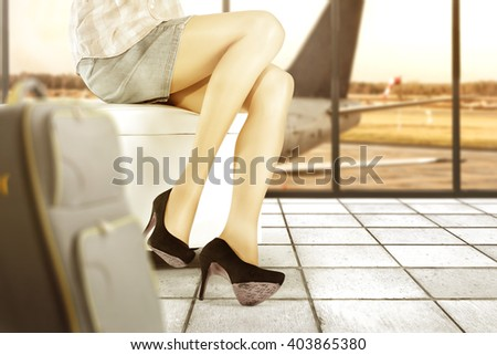 background of airport and sofa and woman legs