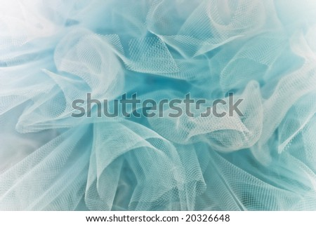 Background of airy blue and white tulle fabric.