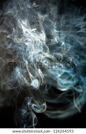 Background of an abstract smoke on a black