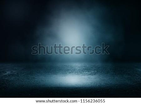 Background of an empty dark room. Empty walls, lights, smoke, glow, rays #1156236055