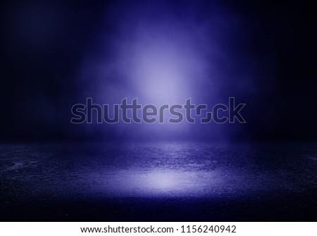 Background of an empty dark room. Empty walls, lights, smoke, glow, rays #1156240942