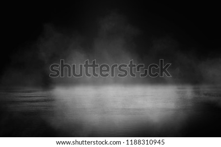 Background of an empty dark room. Empty walls, lights, smoke, glow, rays