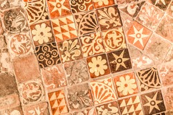 background of ancient medieval floor tiles dating from the 13th century