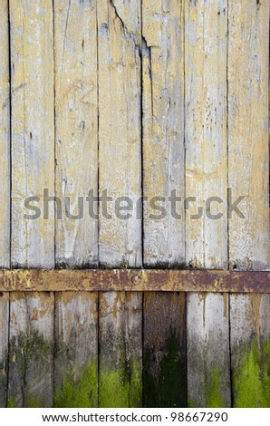 background of ancient retro vintage wooden plank rural building door.