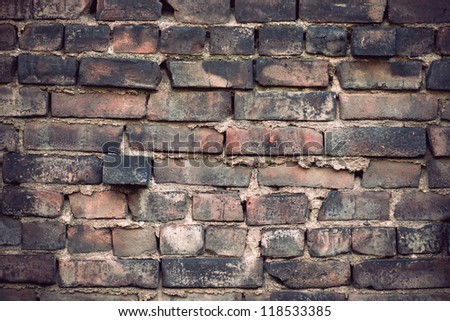 Background of ancient rough weathered brick wall