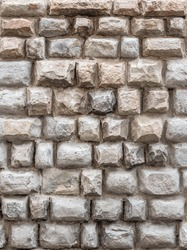 Background of antique wall made of hewn natural stone