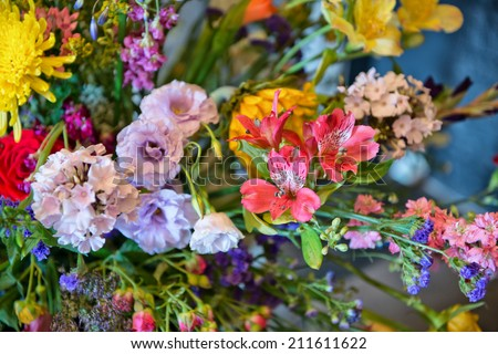 Background of assorted fresh summer flowers in a large bouquet or arrangement in an interior decor and botanical concept
