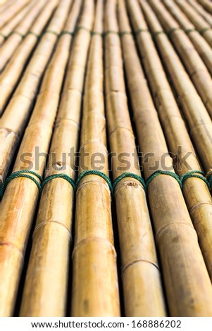 Background of bamboo raft with a rope tightly bonded beautifully  #168886202