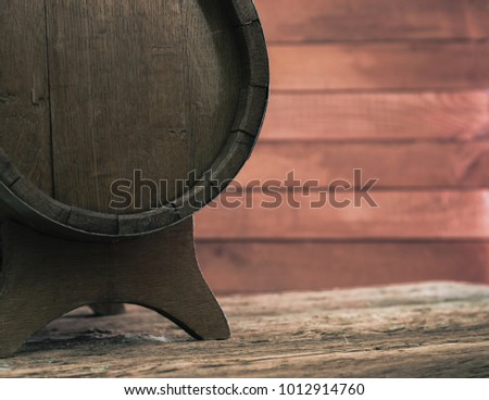 Background of barrel and worn old table of wood #1012914760