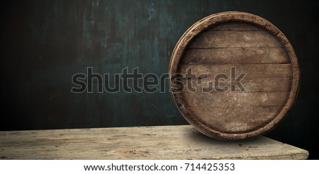 background of barrel and worn old table of wood #714425353