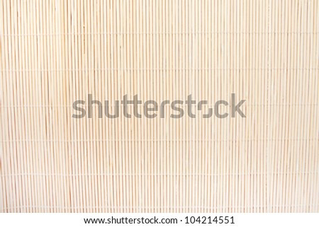 background of beige bamboo mat of fine reeds close up