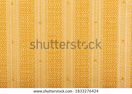 Photo of  Background of beige fabric with vertical stripes. Abstract blank beige striped background, fabric texture, yellow knitted fabric, cotton, wool. Grunge is rough. Seamless pattern