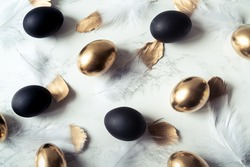 Background of black and gold eggs style minimalism