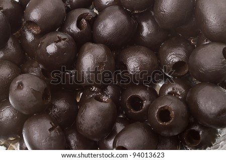 Background of black olives canned. Series of canned foods