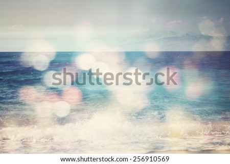background of blurred beach and sea waves with bokeh lights, sandy beach  with turquoise water, bright white sun lights bokeh, travel and summer holidays concept, vintage effect