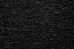 Background of building black brick wall pattern block vintage wallpaper.Dark black tone